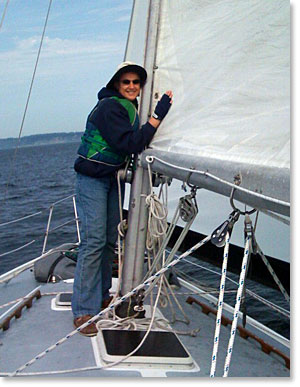 Photo of Capt Kathy Sheehan  kissing the sails of her boat