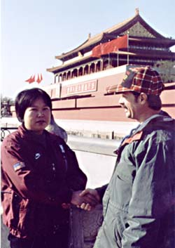 Chuck shaking hands with a chinese woman