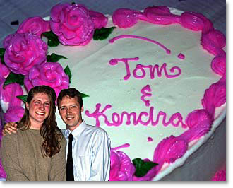 photo of Kendra and Tom and their wedding cake