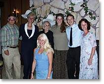 photo of the couple with bride's parents, grandmother, sister, new mother-in-law